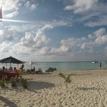 Everything you need to know for a perfect holiday in Isla Mujeres, Mexico. Hotels, restaurants, ferry schedules, golf cart rentals, activities, sites to see, travel tips and much more! The best day trip guide to Isla Mujeres.